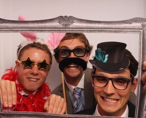 men in photo booth